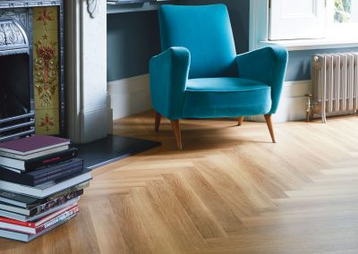 Amtico Spacia Flooring Honey Oak in Herringbone Plank laying pattern